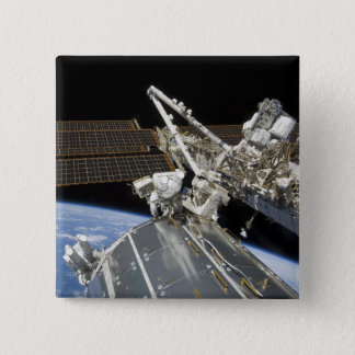 Astronauts perform a series of tasks pinback button
