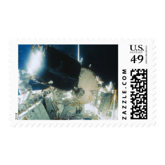 Astronauts Repairing a Satellite in Space Stamps