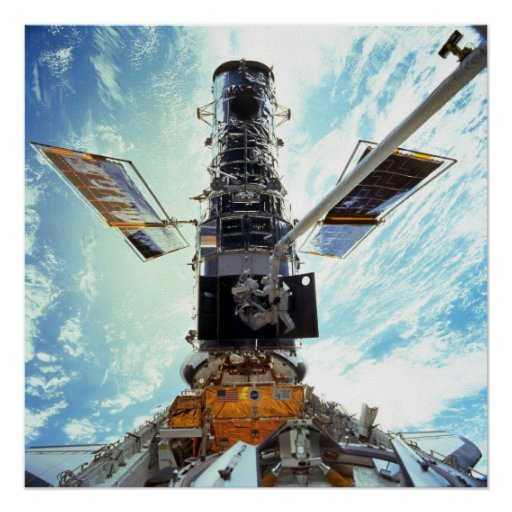 Astronauts work on the Hubble Space Telescope Poster