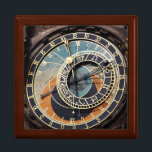 "Astronomical Clock In Prague Keepsake Box<br><div class=""desc"">photography in black blue and orange. detailed color photography of a  historical,  medieval landmark,  an old astronomical clock in prague  in europe with blue,  orange,  and brown,  astrology signs  and roman numerals. photography in blacks blues and oranges.</div>"