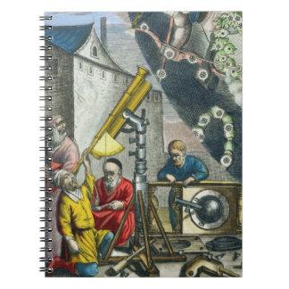 Astrónomos que miran a través de un telescopio, de libro de apuntes