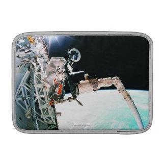 Astronuat Working in Space MacBook Sleeve