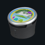 """At The Beach Bumpster Speakers<br><div class=""""desc"""">Bump up the volume of your favorite jams with this At The Beach Bumpster, portable Bluetooth and NFC speaker by OrigAudio. At The Beach Bumpster Speakers features a yellow, white and blue gradient background, palm leaves, purple flowers, beach chairs with umbrella, purple surfboard and ocean. Perfect gifts for anyone who...</div>"""