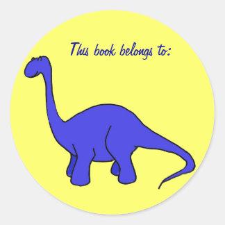 AT- This book belongs to: dinosaur sticker