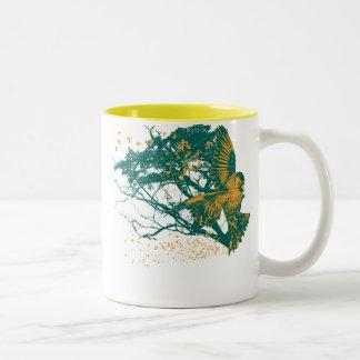 Ataque del pinzón del oro taza de café