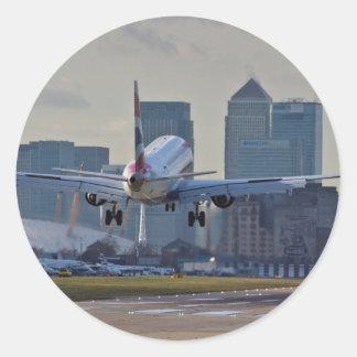 Aterrizaje en el aeropuerto de la ciudad de pegatina redonda
