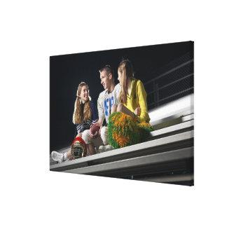 Athletes on bleachers canvas print