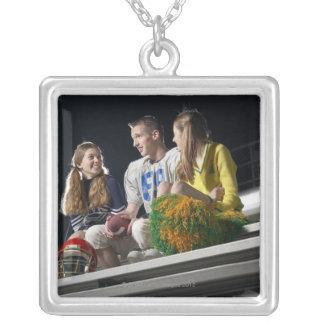 Athletes on bleachers square pendant necklace