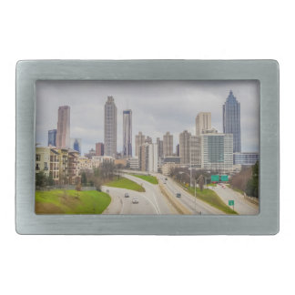 Atlanta skyline over highway belt buckle