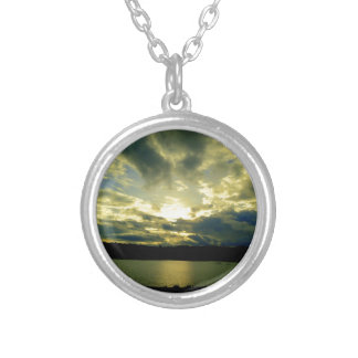 Atmospheric cloudy sky, green, blue, white pendants