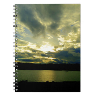 Atmospheric cloudy sky, green, blue, white notebook