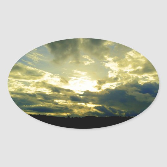 Atmospheric cloudy sky, green, blue, white oval sticker