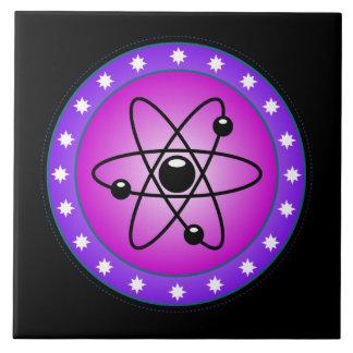 Atom Symbol on a Pink background Ceramic Tile