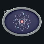 "Atomic Belt Buckle<br><div class=""desc"">Oval belt buckle with an atomic symbol on a dark blue background.</div>"