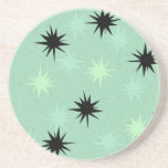 "Atomic Jade &amp; Mint Starbursts Sandstone Coaster<br><div class=""desc"">This Atomic Jade and Mint Starbursts Sandstone Drink Coaster has all of the mid century modern fun of your grandma's kitchen, minus the sticky linoleum. The kitschy design features a jade background with gold speckles and randomly placed starbursts in black, jade, and mint. This vintage inspired pattern is mod enough...</div>"