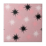 """Atomic Pink Starbursts Ceramic Tile<br><div class=""""desc"""">This Atomic Pink Starbursts Ceramic Tile has all of the mid century modern fun of your grandma's kitchen, minus the sticky linoleum. The kitschy design features a pink background with gold speckles and randomly placed starbursts in black and two shades of pink. This vintage inspired pattern is mod enough to...</div>"""