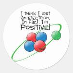 Átomo positivo etiqueta redonda