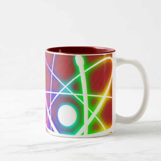 Átomo que brilla intensamente colorido - taza
