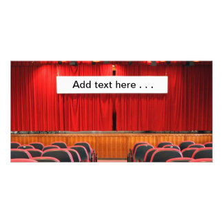 Auditorium with Red Curtains and Banner Card
