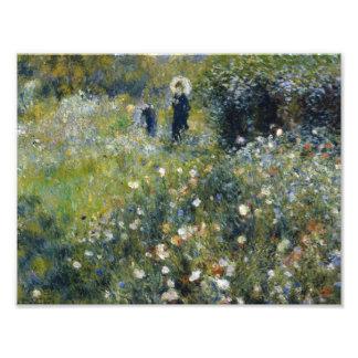 Auguste Renoir - mujer con un parasol en un jardín Cojinete