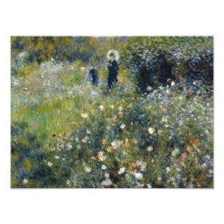 Auguste Renoir - mujer con un parasol en un jardín Fotografías