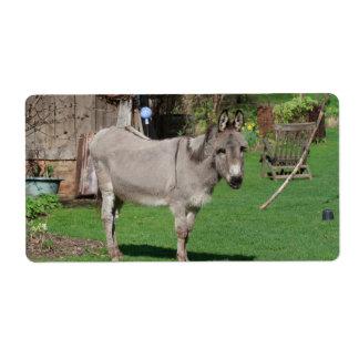 Aún vida rural con el burro etiquetas de envío