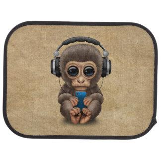 Auriculares que llevan del mono lindo del bebé alfombrilla de auto