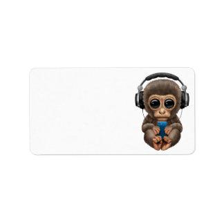 Auriculares que llevan del mono lindo del bebé etiquetas de dirección