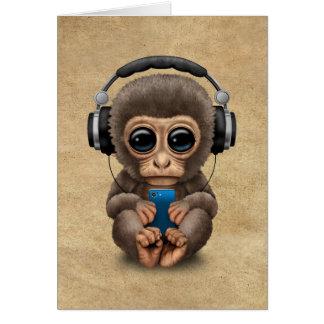 Auriculares que llevan del mono lindo del bebé tarjeta pequeña