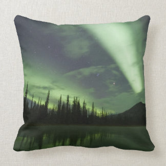 Aurora borealis are reflected in tundra pond throw pillow