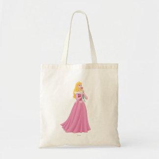 Aurora que sostiene la flor bolsa