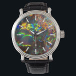 """Aussie Fire Opal Watch<br><div class=""""desc"""">Australian Fire Opal illuminated from the back to bring out the vivid colors. Delete the tick marks on the clock face if you like, or try other styles of watches with this glittery faux-opal background. &quot;Available on more products&quot; with the link to the right. ✣ Try our other stores on...</div>"""
