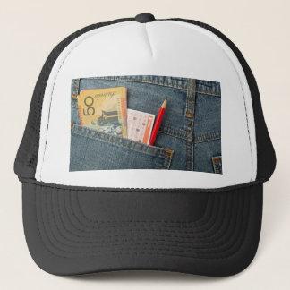 Australian money and lottery bet slip in pocket trucker hat