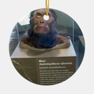 Australopithecus afarensis; museum exhibit. ceramic ornament