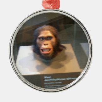 Australopithecus africanus; museum exhibit round metal christmas ornament