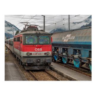 Austria. ÖBB 1142 608 - 7 passes by. Postcard