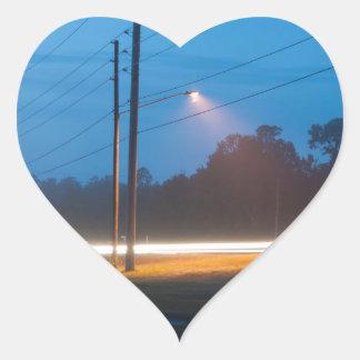 Automobile headlights early morning fog heart sticker