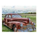 Automóvil clásico viejo oxidado del vintage del postal