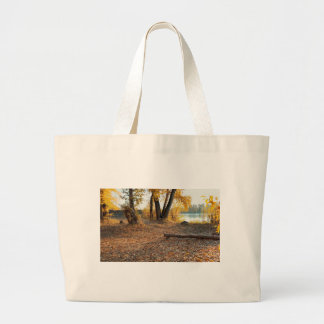 Autumn by the River Canvas Bags
