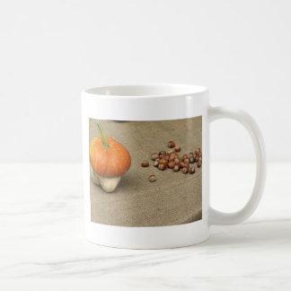 Autumn composition with pumpkin and hazelnuts coffee mug