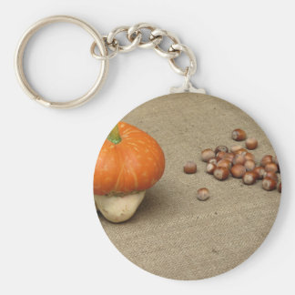 Autumn composition with pumpkin and hazelnuts keychain