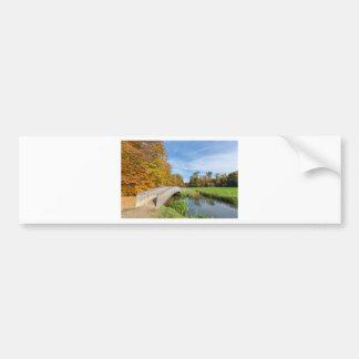 Autumn forest landscape with wooden bridge over wa bumper sticker