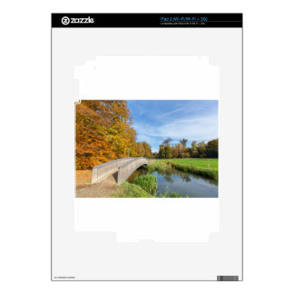 Autumn forest landscape with wooden bridge over wa decal for the iPad 2