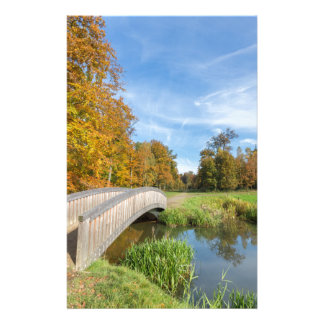 Autumn forest landscape with wooden bridge over wa stationery