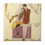 """Autumn in France Art Deco Tile<br><div class=""""desc"""">Autumn in France Art Deco. Georges Barbier art deco illustration. One of French illustrator Georges Barbier's season illustrations, Autumn features a cute couple sitting on a statue as the leaves begin to turn around them. Doves dip and dive around them, and the colors are very typical of Barbier's best work....</div>"""