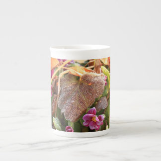autumn leaf in early spring tea cup