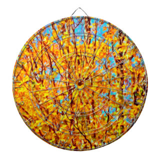 Autumn leaves against blue sky 2 dartboard with darts