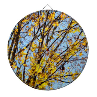 Autumn leaves against blue sky dart boards