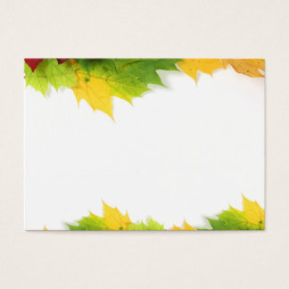 Autumn leaves on edge with white space business card