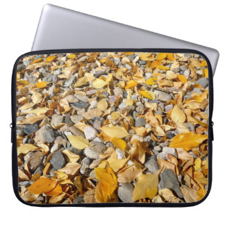 Autumn Leaves on Rocks in Riverbed laptop sleeve